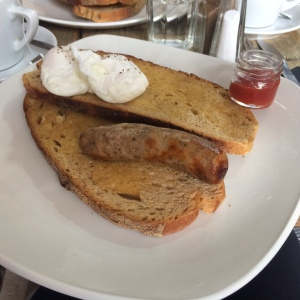 Poached eggs and sausage